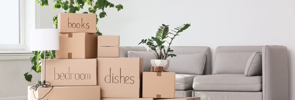 An image of boxes labeled for moving homes.